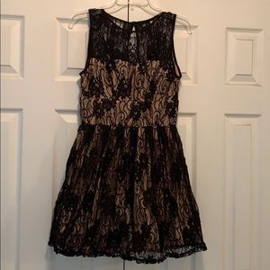 Black lace over nude party dress